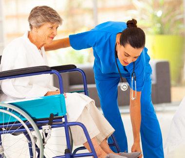 female caregiver and elder in wheelchair